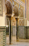 Royal Alcazar in Seville, Spain. Details of arches decorating rooms of the so called Palacio de Don Pedro inside the Royal Alcazar in Seville. The palace is Stock Photo