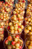 Royal ann cherries. Vertical rows of royal ann cherries in clear cups Royalty Free Stock Photo