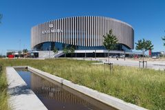 Royal Arena, Orestad, Copenhagen, Denmark with reflection in water Stock Photo
