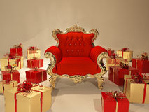 Royal armchair with golden frame and gift box Stock Photography