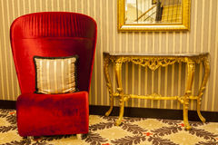 Royal Armchair in red in warm athmosphere decoration. Homestyle living stock photos