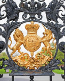 Royal Arms. The Royal Coat of Arms on the gate of Kew Garden in London, England Royalty Free Stock Image