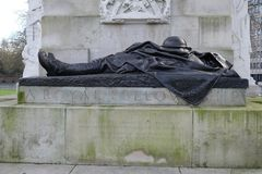 Royal artillery memorial, Hyde Park Corner, London,UK. Bronze statue of a fallen soldier,part of the Royal artillery memorial in Hyde Park Corner,London Stock Photography