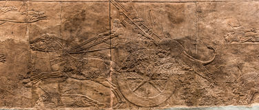 Assyrian chariot during the lion hunt Stock Photography