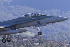 Royal Australian Air Force RAAF McDonnell Douglas F/A-18B Hornet jet taking off from Illawarra Regional Airport. stock photos