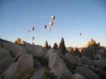 Royal ballons flying in the sunrise light in Cappadocia, Turkey above the Fairy Chimneysrock formationnearby Goreme Stock Image