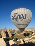Royal ballons flying in the sunrise light in Cappadocia, Turkey above the Fairy Chimneysrock formationnearby Goreme Royalty Free Stock Photo