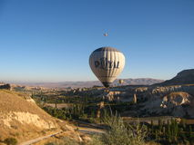 Royal ballons flying in the sunrise light in Cappadocia, Turkey above the Fairy Chimneys rock formation nearby Goreme Stock Image