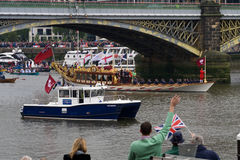 The Royal Barge heads heads off. The Royal Barge Gloriana, heads down river as part of the Thames Pageant to mark the Diamond Jubilee Royalty Free Stock Image