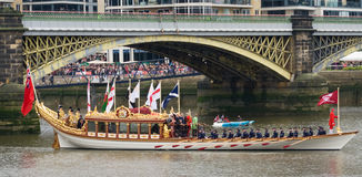 The Royal Barge heads heads off. The Royal Barge Gloriana, heads down river as part of the Thames Pageant to mark the Diamond Jubilee Royalty Free Stock Photos
