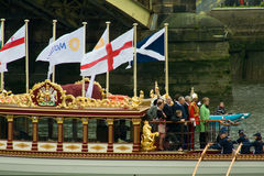 The Royal Barge heads heads off Stock Photos