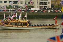The Royal Barge heads heads off. The Royal Barge Gloriana, heads down river as part of the Thames Pageant to mark the Diamond Jubilee - showing the glorious Stock Images