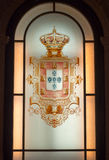 Royal blazon. Portuguese royal blazon in stained-glass window Stock Photo