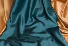 Royal Blue and Gold Satin Background Stock Photography