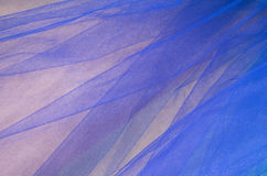 Royal Blue Tulle on Gold Satin Fabric Background Royalty Free Stock Photo