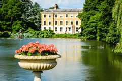 Royal Botanic Gardens, Kew. The beautiful lake in the Royal Botanic Gardens of Kew in London provides peace and calm - a must-see attraction for tourists stock image