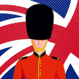 Royal British guard. Man in traditional uniform and flag United Kingdom Stock Images