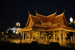 Royal Buildings in Bangkok Thailand. Royal Buildings illuminated by lights in the evening close to the palace in Bangkok Thailand Southeast Asia Stock Photo