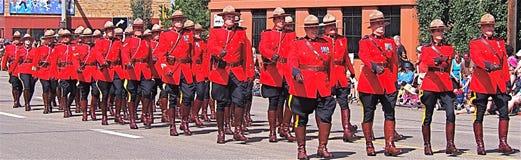 Royal Canadian Mounted Police marching. Royal Canadian Mounted Police  marching in Edmonton Exhibition parade July 2012 Stock Photography