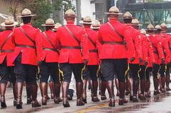 Royal Canadian Mounted Police Officers Marching In Parade Stock Photo