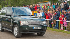 Royal car met by crowds at Braemar. The Queen's car arriving at the Braemar Royal Gathering held on 1st September 2012 with a large crowds attending to welcome Stock Image