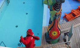 Lifeguard for the Royal Caribbean Cruise Line. Royal Caribbean Adds Lifeguards for All Swimming Pools. Starting this week, all pools onboard Royal Caribbean royalty free stock photos