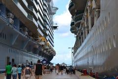 Royal Caribbean Cruise ships. The Royal Caribbean Cruise ships, Oasis and Serenade  docked at Cayman Island Stock Photography