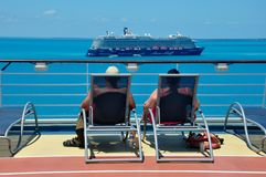 Royal Caribbean international cruise ship passengers. On sun deck looking at TUI Cruises Mein Schiff cruise ship royalty free stock photography