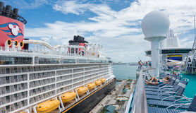 Royal Caribbean`s Majesty of the Seas and Disney Dream ships. NASSAU, BAHAMAS - OCT 15, 2016: Royal Caribbean`s Majesty of the Seas and Disney`s Disney Dream Stock Image