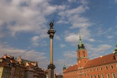 Royal Castle and Sigismund`s Column in Old Town of Warsaw, Poland. Royal Castle and Sigismund`s Column Kolumna Zygmunta next to traditional buildings in Old Town Royalty Free Stock Image