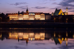 Royal Castle and Vistula River at Twilight in Warsaw. Royal Castle illuminated at twilight with reflections on the Vistula river waters in the Old Town of Warsaw royalty free stock image