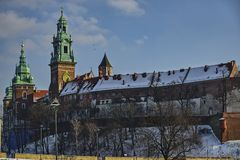 Castle on a hill. The Royal Castle on Wawel Hill on a clear winter day Stock Photos