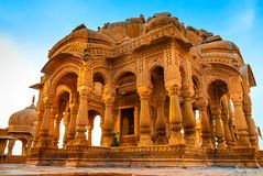 Bada Bagh in Jaisalmer, Rajasthan, India. Cenotaphs made of yellow sandstone at sunset. The royal cenotaphs of historic rulers, also known as Jaisalmer Chhatris stock images