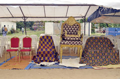 ROYAL CHAIR. Traditional chair installed to welcome the king. The ornaments present at these meetings serve to distinguish the hierarchical rank Royalty Free Stock Photos