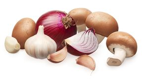 Royal champignon mushrooms, unpeeled red onion and garlic stock images