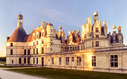 The royal Chateau de Chambord at sunset, castle in France Stock Photography