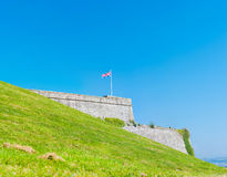 Royal Citadel in Plymouth. An Union Jack flag flying on top of the massive fortification walls of the Royal Citadel in Plymouth Stock Photos