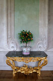 Royal Clementines. Orange tree in a pot / vase on an ornate table Royalty Free Stock Photo