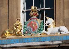 Royal coat of arms. Royal crest or coat of arms on building Royalty Free Stock Image