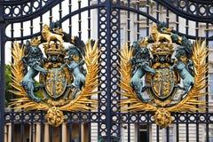 Royal Coat of Arms at Buckingham Palace. Details of the gates in front of Buckingham Palace in London Stock Photography