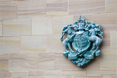 Royal Coat of Arms (Queen Elizabeth II). The Queens royal coat of arms, made from what looks to be copper. The Latin translates to god and my right Royalty Free Stock Photo