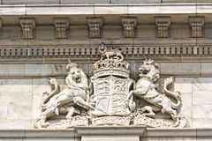 Royal Coat of Arms of the UK. Royal Coat of Arms of the United Kingdom on the wall of Victoria Monument in Calcutta Stock Photo
