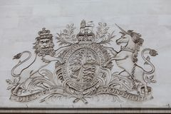 Royal coat of arms of the United Kingdom, bas-relief on the facade of building, London, United Kingdom. Royal coat of arms of the United Kingdom, bas-relief on Royalty Free Stock Photography