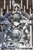 Royal coat of arms of the United Kingdom on the metal gate, London, United Kingdom. It is the official coat of arms of the British monarch, currently Queen Stock Photos