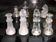 Royal Court. Chess pieces and board with a glow Stock Photos