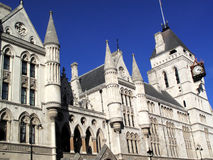 Royal Courts of Justice. The Royal Courts of Justice erected between 1874 and 1882 are England and Wales' highest civil legal law courts Royalty Free Stock Photo