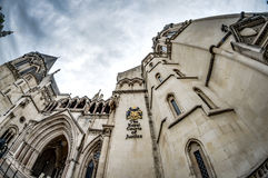 Royal Courts of Justice. The facade of the Royal Courts of Justice in London, England showing the coat of arms of the courts and architectural details Royalty Free Stock Image
