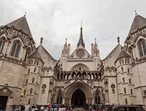 Royal Courts of Justice London. The facade of the historical building with its gothic windows and doors, Royal Courts of Justice, downtown London, England Royalty Free Stock Images