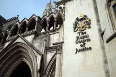 Royal Courts of Justice. Part of the exterior facade of the Royal Courts of Justice in London, England showing the coat of arms of the courts and architectural Stock Images