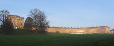 Royal Crescent. Famous example of Georgian architecture, Bath, UK. Afternoon winter light, with slight mist softening the scene Stock Images